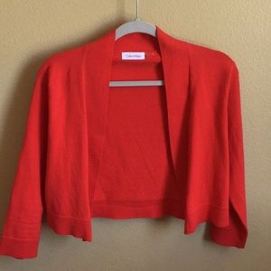 Calvin Klein long sleeved red shrug size medium